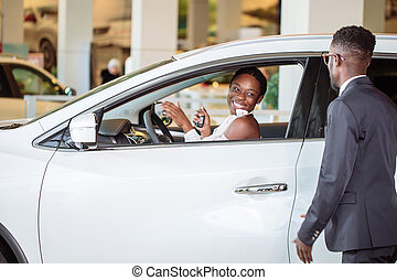 young woman surprised by new car, gift for my beautiful wife