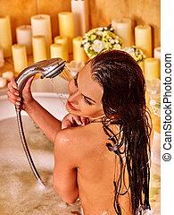 Young woman take bubble bath. - Young woman take shower in...
