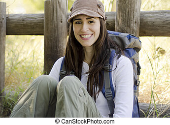 Young woman taking a break on trip