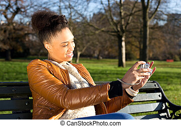 young woman taking a photo with a compact camera