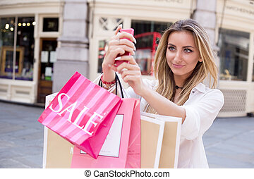 selfie - young woman taking a selfie