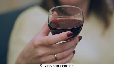 Young woman taking a sip from wine glass