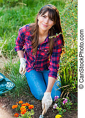 Young woman taking care of flowers