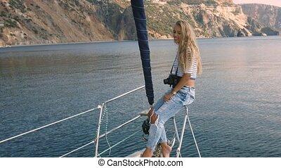 Young woman taking photo of beautiful sea lagoon