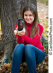 young woman taking photo