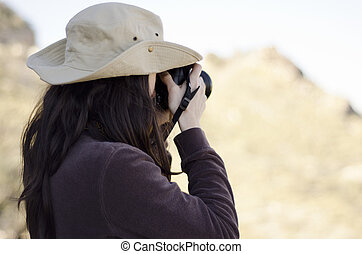 Young woman taking pictures on trip