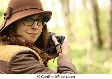 Young woman taking pictures with an SLR camera.