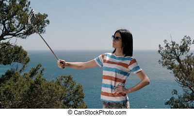 Young Woman Taking Selfie Photo Using Smartphone Outdoors -...