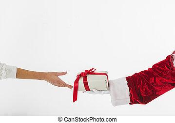 Young woman taking small gift box santa claus.