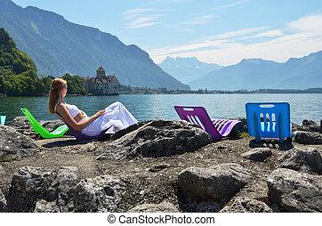 Young woman taking sunbath at Geneva lake, Switzerland