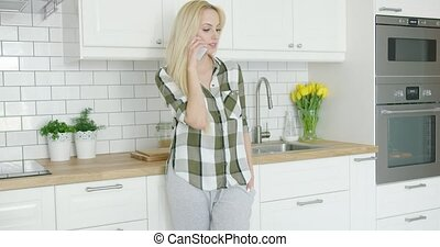 Young woman talking by phone - Beautiful young female in...