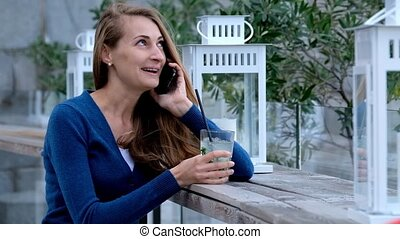 Young woman talking by smart phone