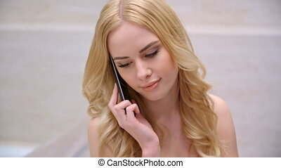 Young Woman Talking Cell Phone in Her Bathroom