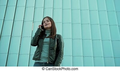 Young Woman Talking Happily on Her Phone