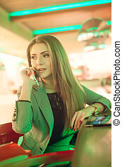 Young woman talking on a cell phone