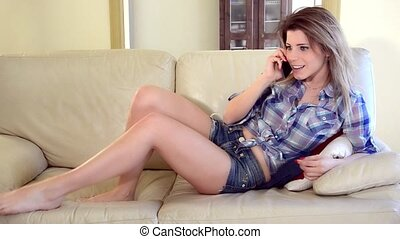 young woman talking on her mobile p - Modern beautiful girl...