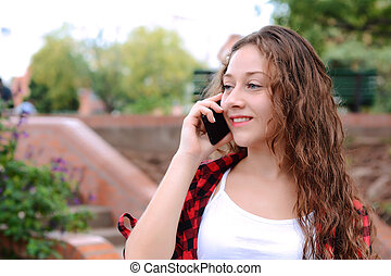 Young woman talking on her mobile phone.