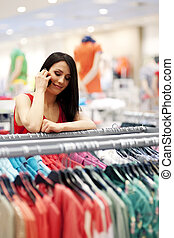 Young woman talking on mobile phone in store