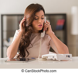 Young Woman Talking On Telephone