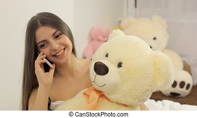 Young woman talking on the mobile phone.