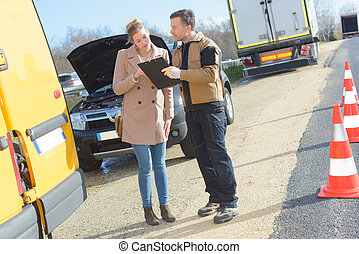 young woman talking to assistance car service