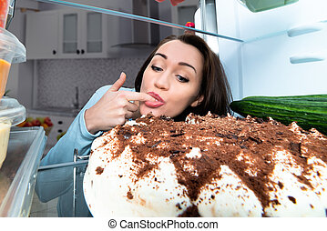 Young Woman Tasting Cake