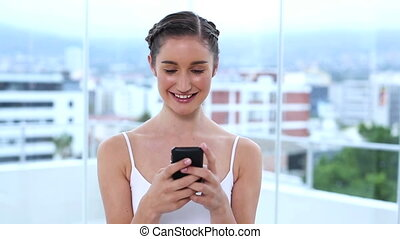 Young woman texting message in apartment