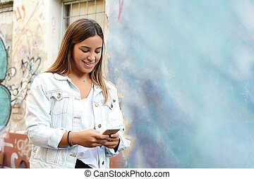 Young woman texting on her mobile phone.