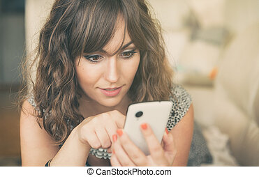Young woman texting on her mobile phone