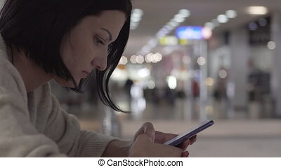 Young Woman Texting On Smartphone Writing Message In Crowded...