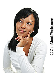 Young woman thinking - Thoughtful black woman looking up ...