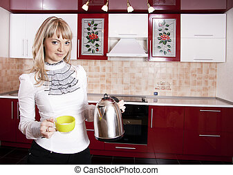 Young woman to kitchen in red-white color