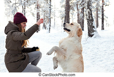 Young woman to train a dog in the street