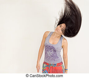 Young woman tossing her hair