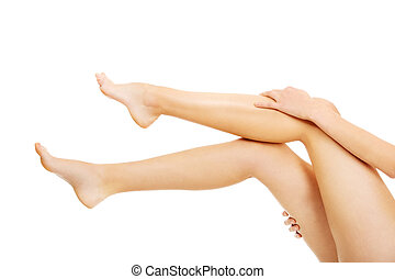 Young woman touching her legs