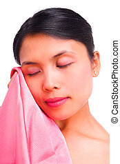 Young woman touching smooth satin with her face
