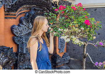 Young woman tourist on the background of Tanah Lot - Temple in the Ocean. Bali, Indonesia