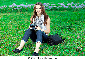 young woman tourist resting on the grass