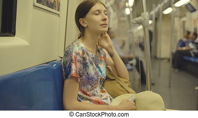 Young woman tourist travelling in subway and looking in map...