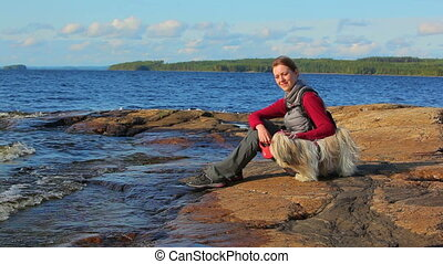 Young woman tourist with dog.