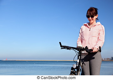Young woman tracking her route on smartphone gps. Bicycle ...