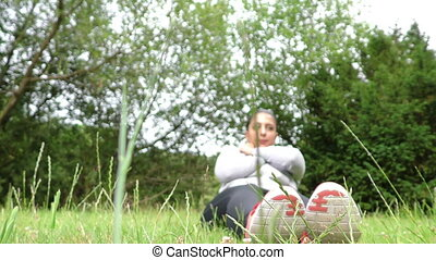 Young Woman Training on Grass in Na