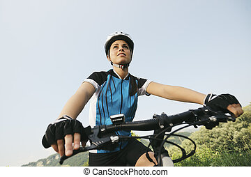 young woman training on mountain bike and cycling in park....