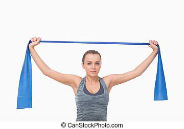 Young woman training using a resistance band