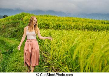 Young woman traveler on Beautiful Jatiluwih Rice Terraces ...
