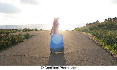 Young woman traveler runs with a suitcase