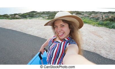 Young woman traveler taking selfie