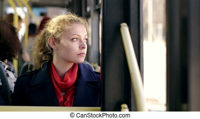 Young woman traveling by bus on a sunny day