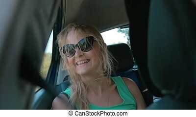 Young woman traveling by car and looking out window