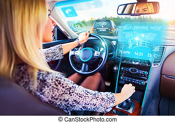 Young woman traveling in self driving car